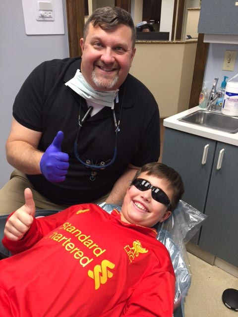 Dr. Baccellieri Jr. with a happy teenager after his treament at Baccellieri Family Dentistry.